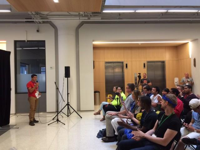 Executive Director of GlobalHack, Matt Menietti, addressing the crowd Sunday afternoon.