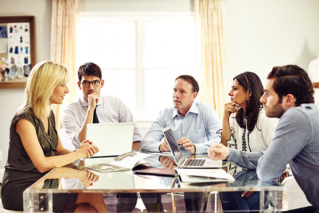 Anjali Kamra of Rungolee and Jimmy Sansone of The Normal Brand, two leading St. Louis fashion businesses, with St. Louis Fashion Incubator Executive Director Eric Johnson (second from left) and Simplify Commerce's Ciara Hickey (far left) and Keith Ingenthron (middle). Photo by Wesley Law.